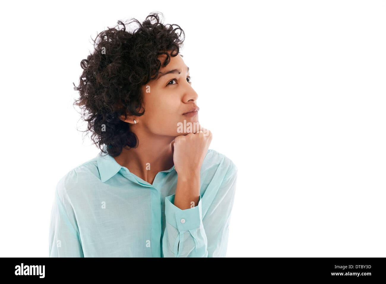 Portrait de confus et incertain hispanic business woman on white background Photo Stock