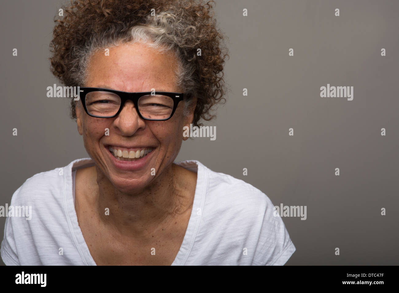 Studio portrait of happy senior woman Photo Stock