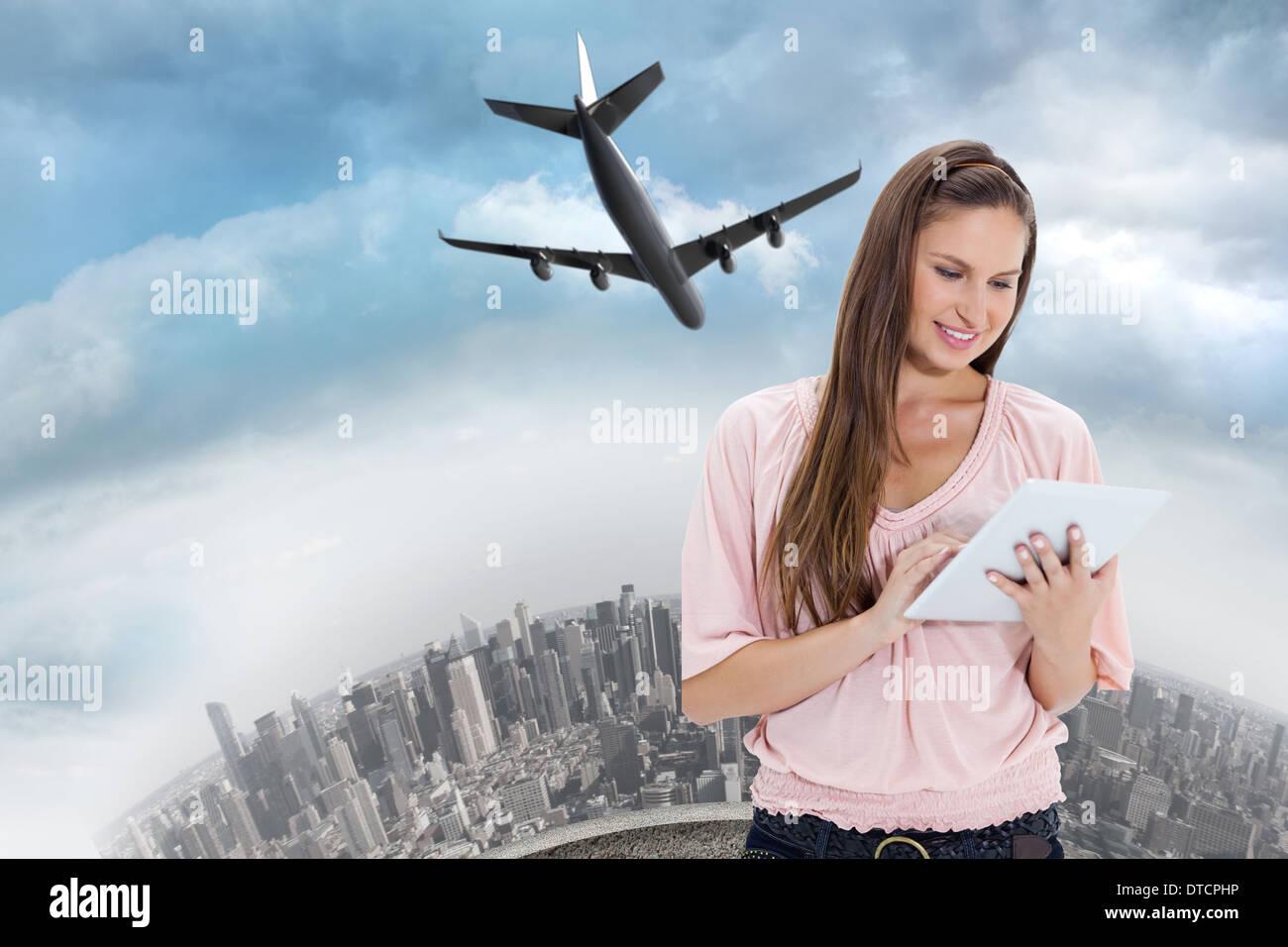 Composite image d'une fille à l'aide d'un pavé tactile Photo Stock