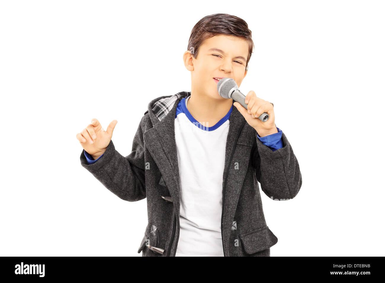 Boy en chantant dans le microphone Photo Stock
