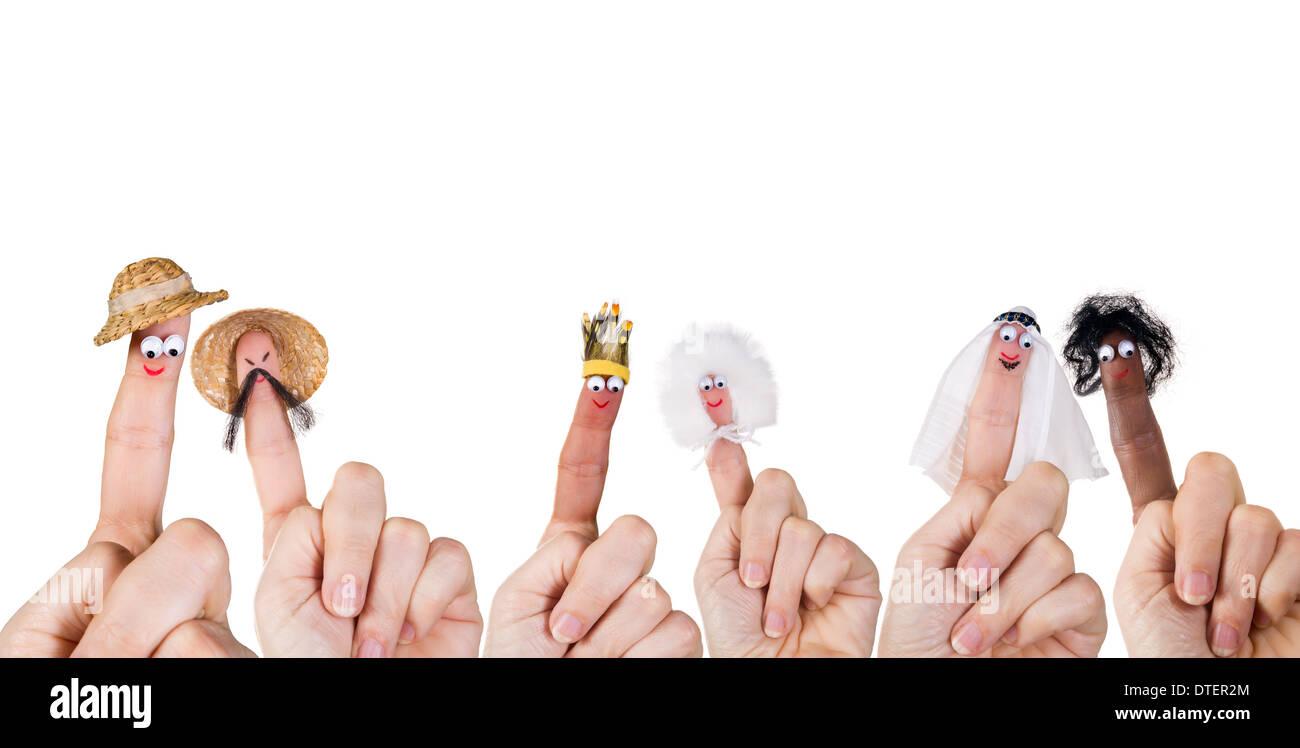 Les races humaines et diversité symbolisé avec des marionnettes à doigt Photo Stock