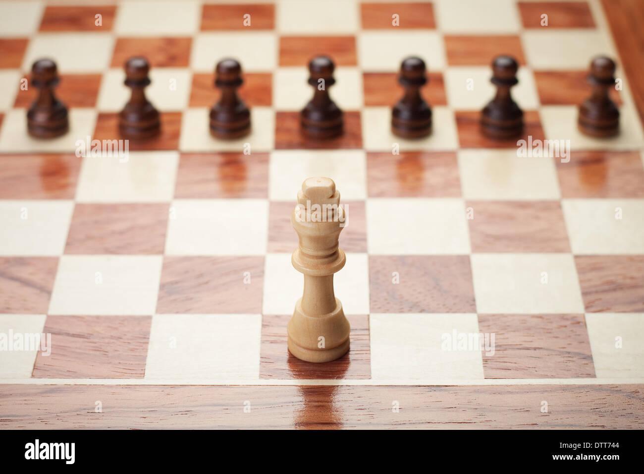Concept d'échecs sur fond gris Photo Stock
