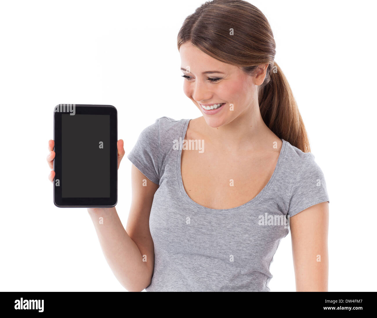 Cheerful woman présentant une surface tactile, communication concept Photo Stock