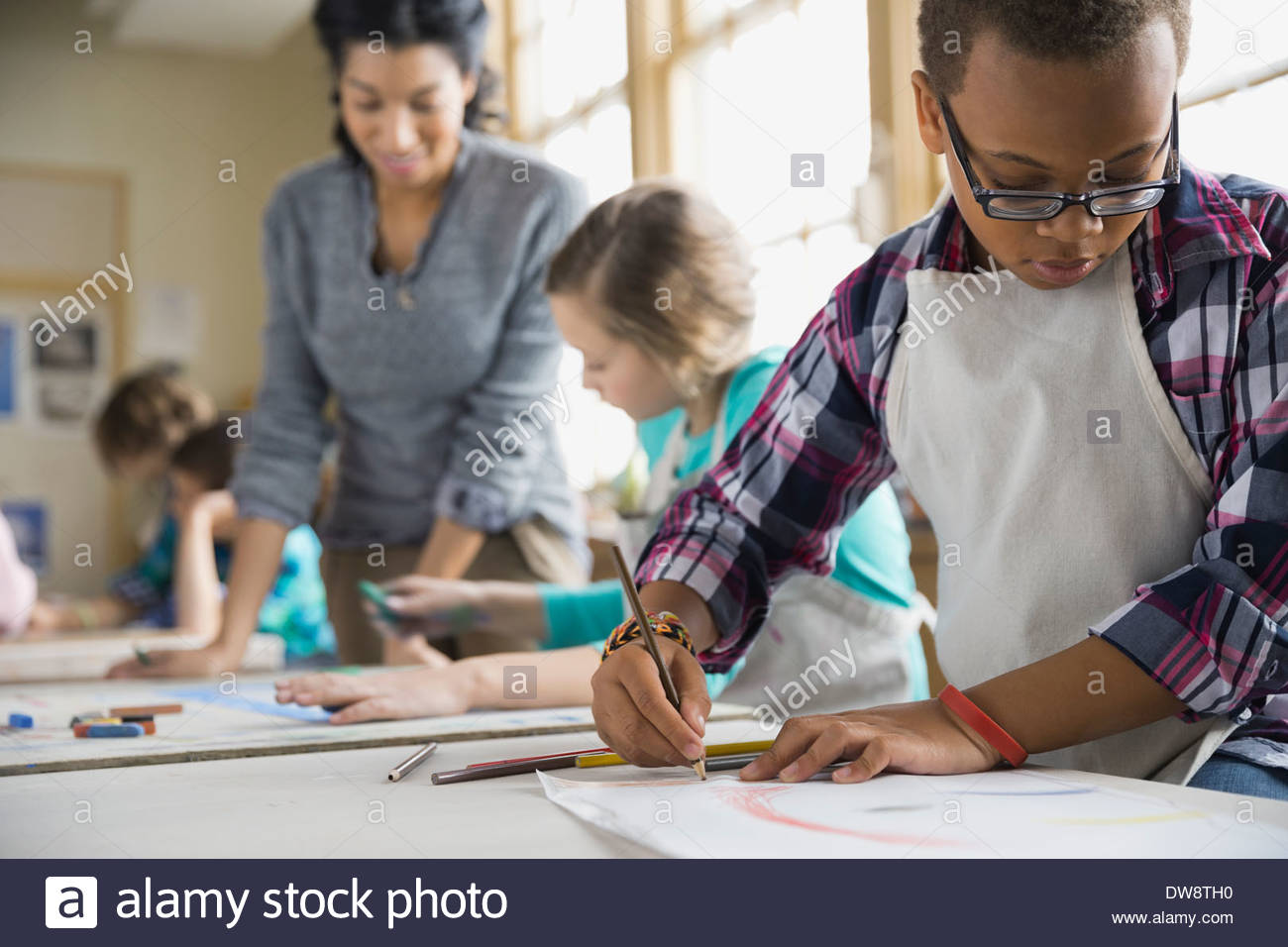 Boy drawing in art class Photo Stock