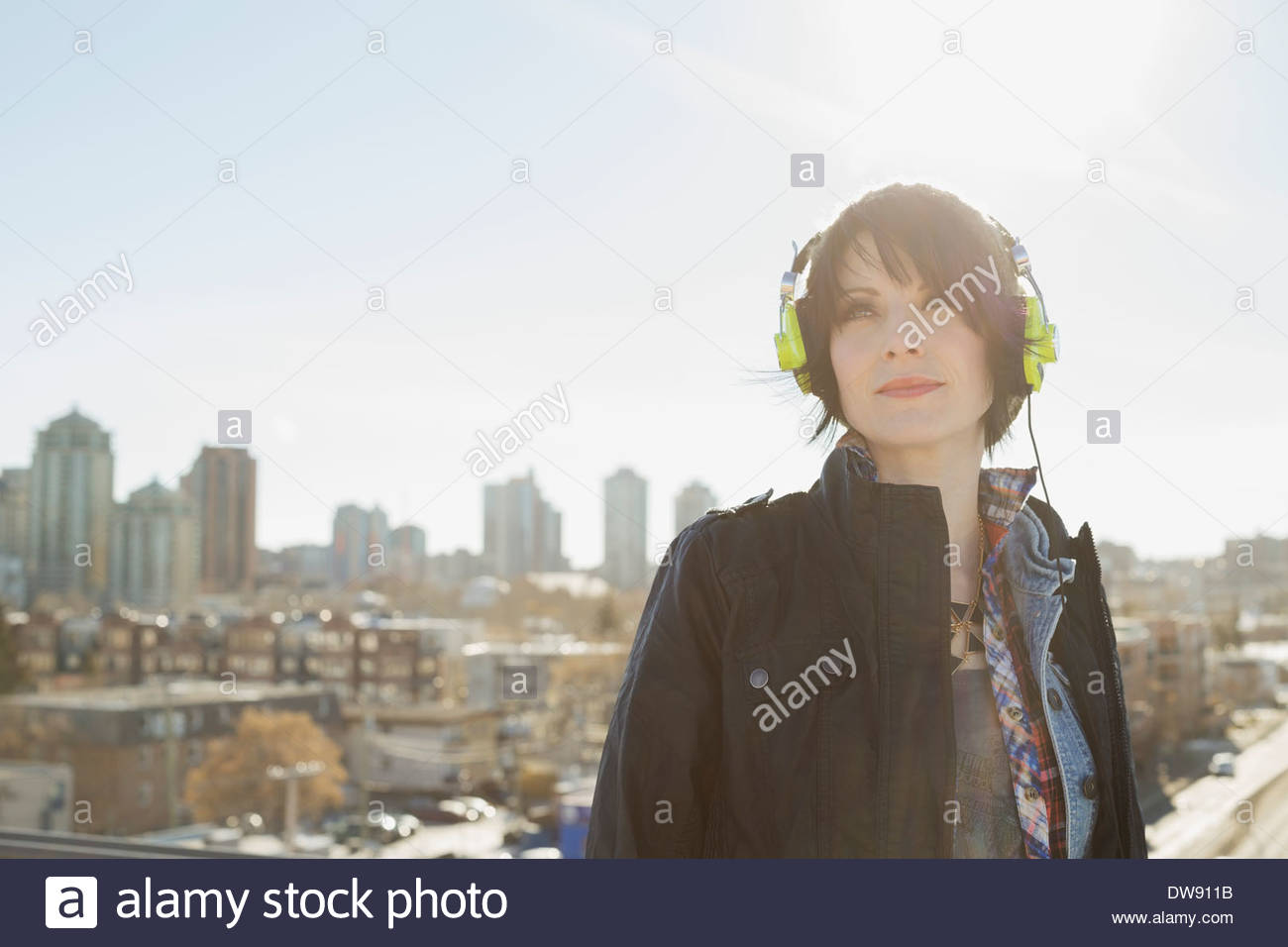 Woman listening to headphones outdoors Photo Stock