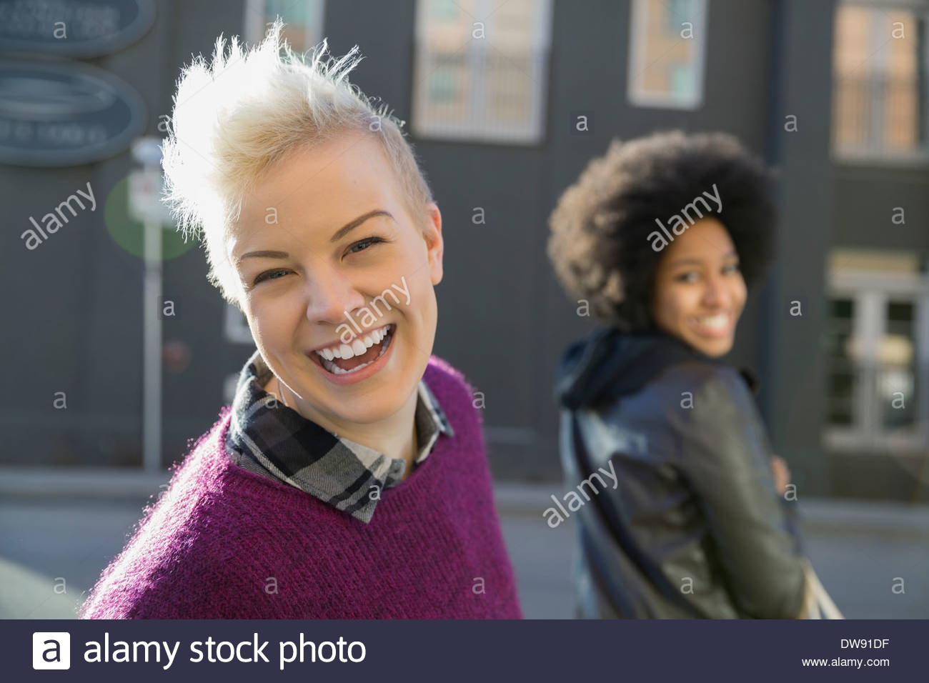 Portrait of smiling woman on city street Photo Stock