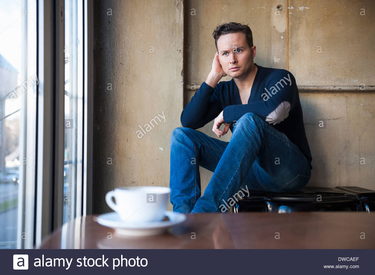 Portrait of mid adult man sitting in cafe Photo Stock