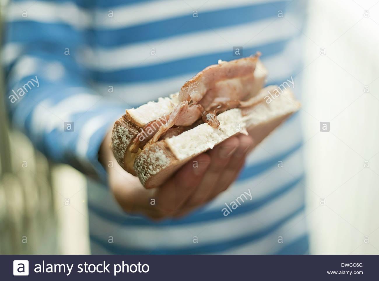 Boy holding sandwich bacon Photo Stock