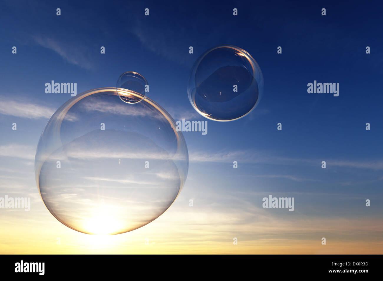 Effacer des bulles de savon dans le ciel au coucher du soleil - 3D render Photo Stock
