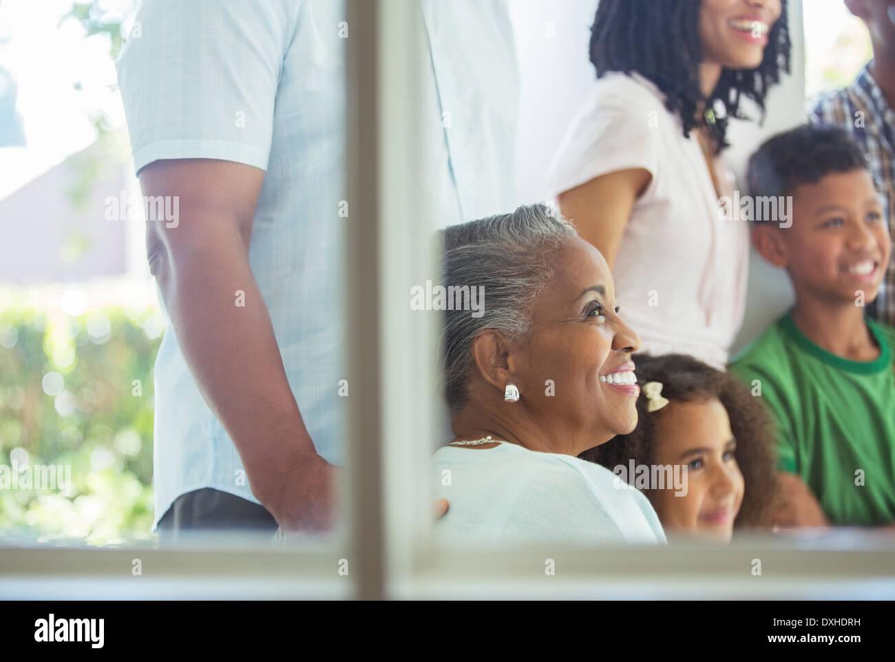 Happy family on porch Photo Stock