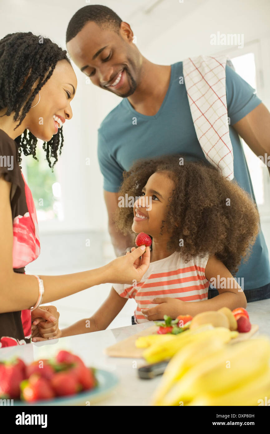 Happy Family eating strawberries Photo Stock