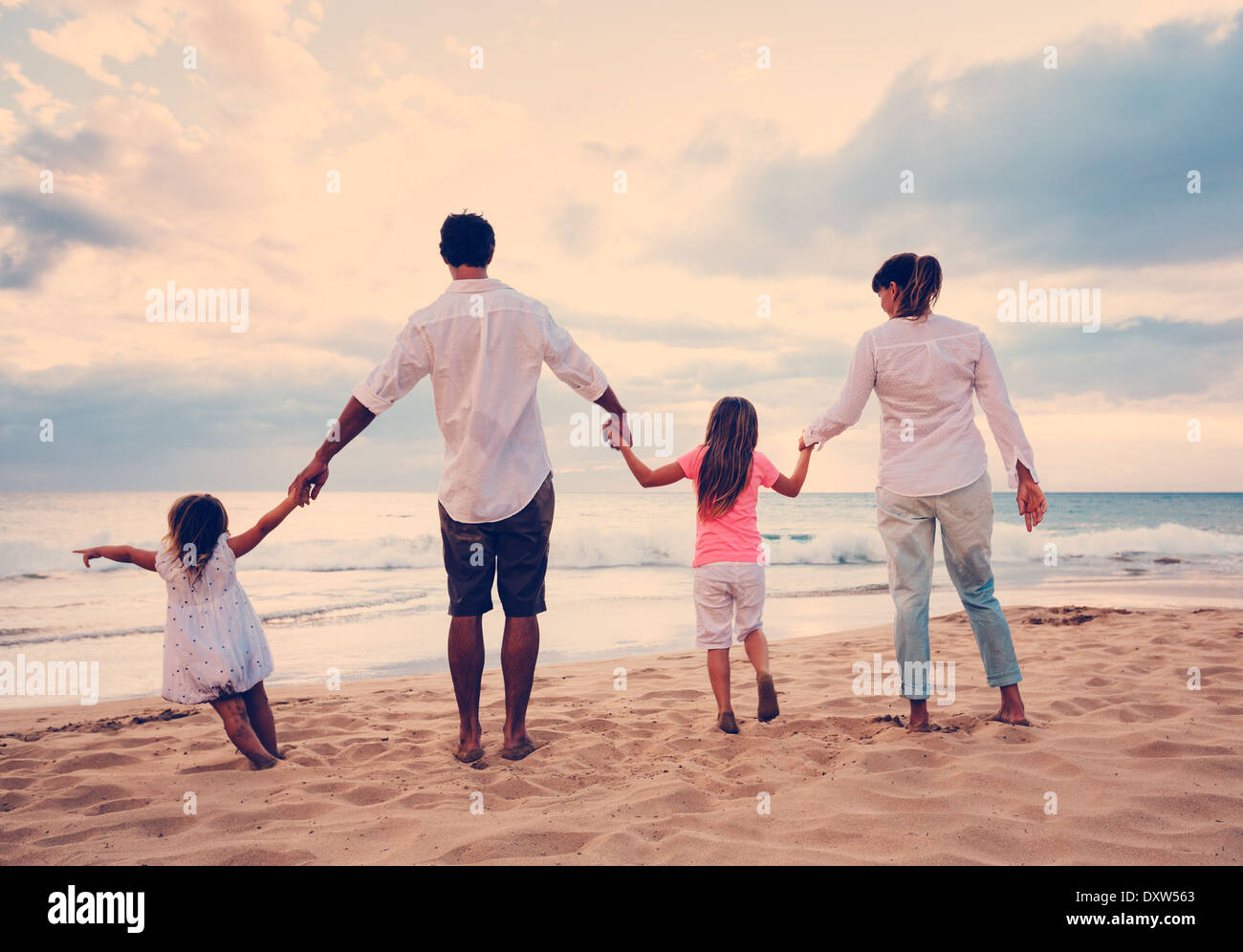 Happy Family having fun on Beach at Sunset Photo Stock