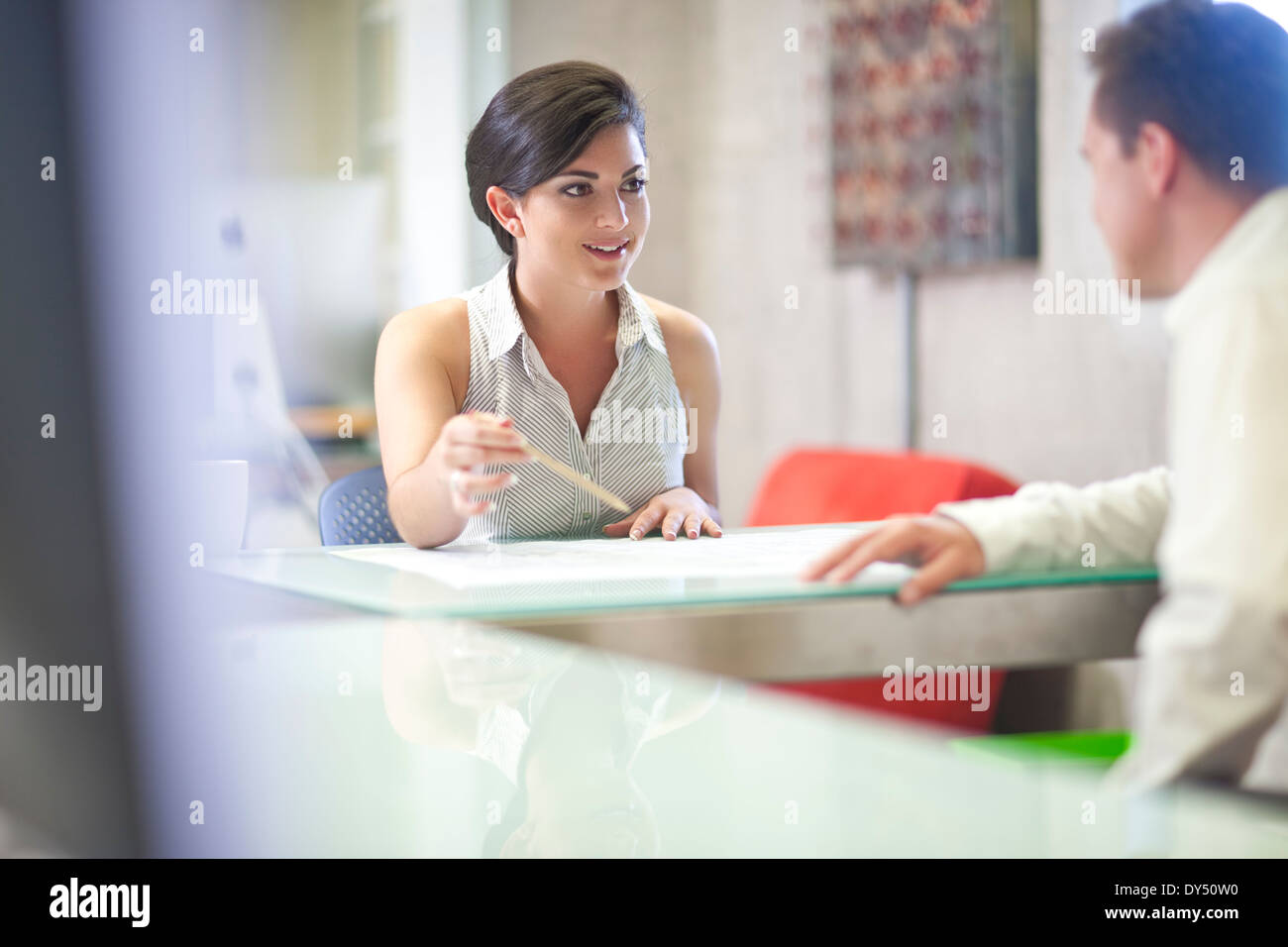 Young businesswoman meeting client in office Photo Stock