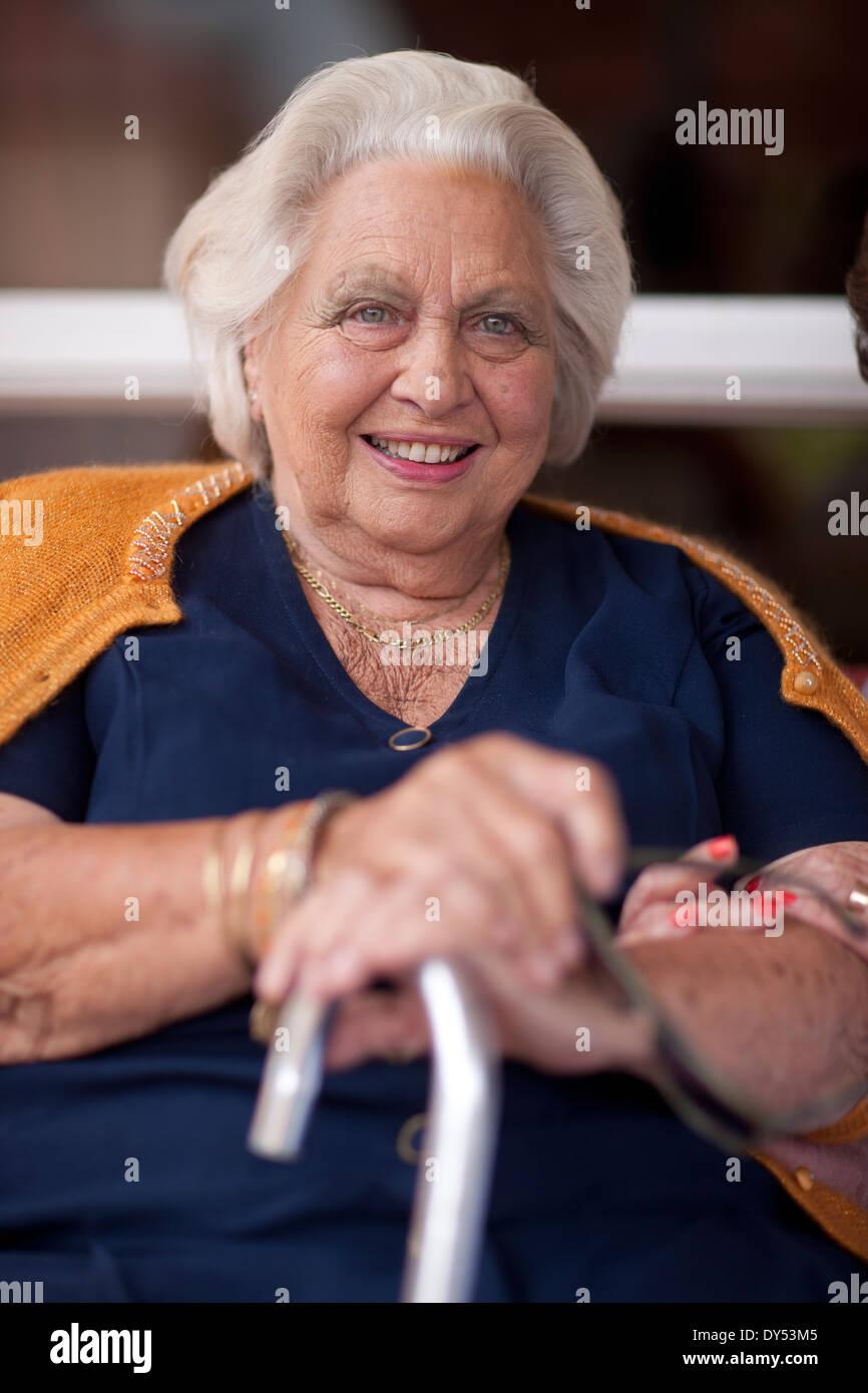 Portrait of senior woman holding walking stick Photo Stock
