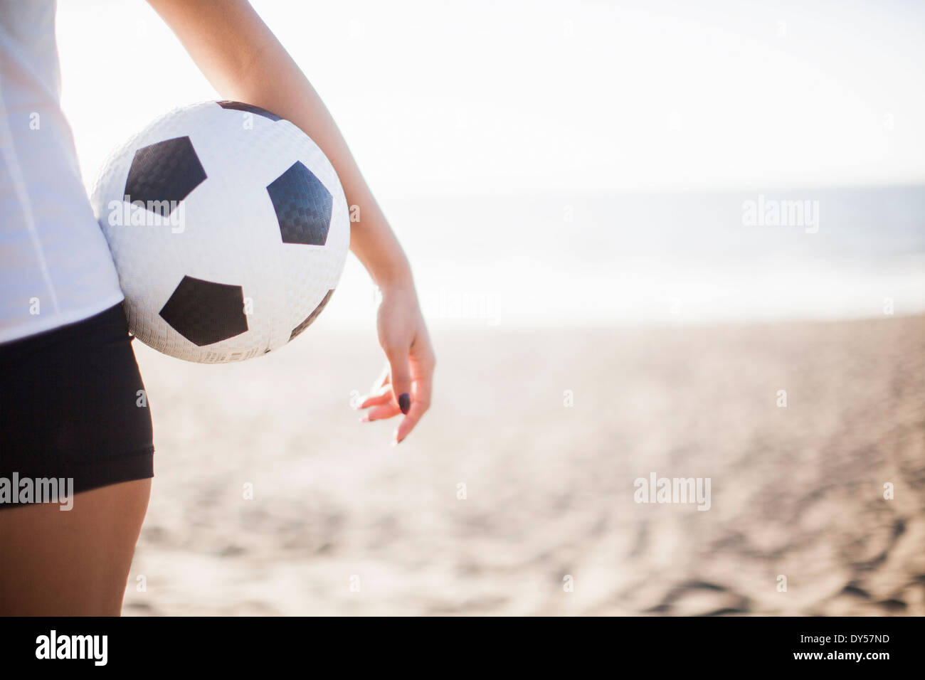 Young woman holding football Photo Stock