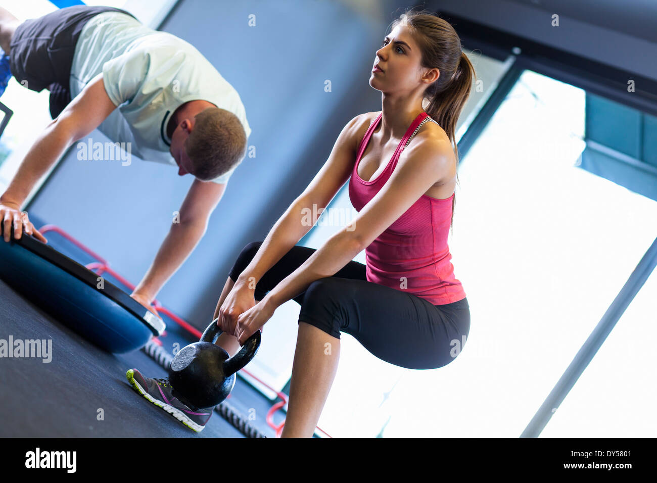 Couple working out in gym Photo Stock