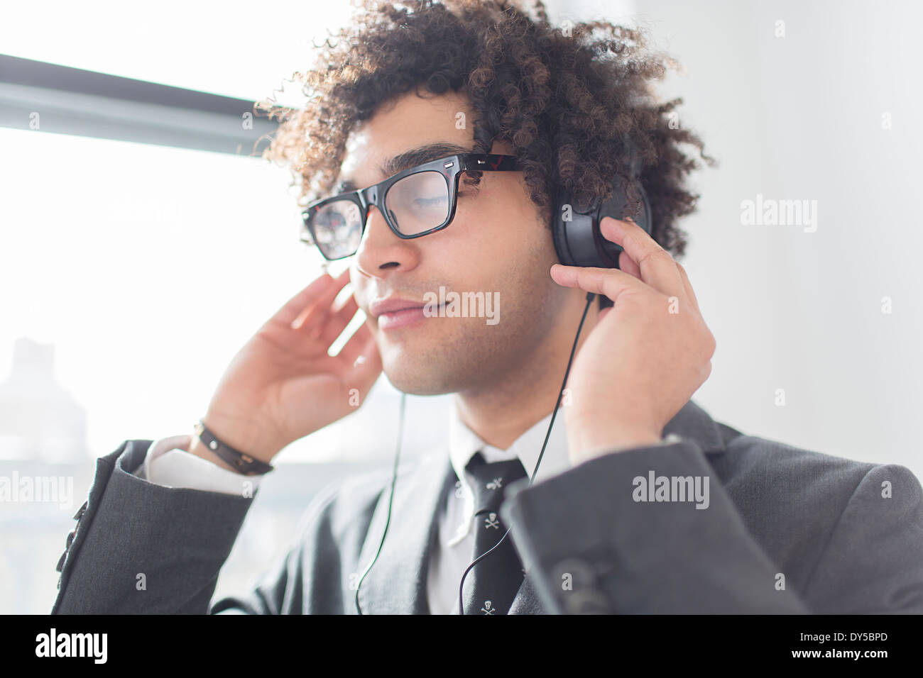 Young man wearing headphones Photo Stock