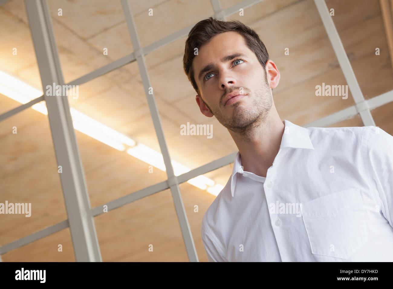 Businessman standing with serious expression Photo Stock