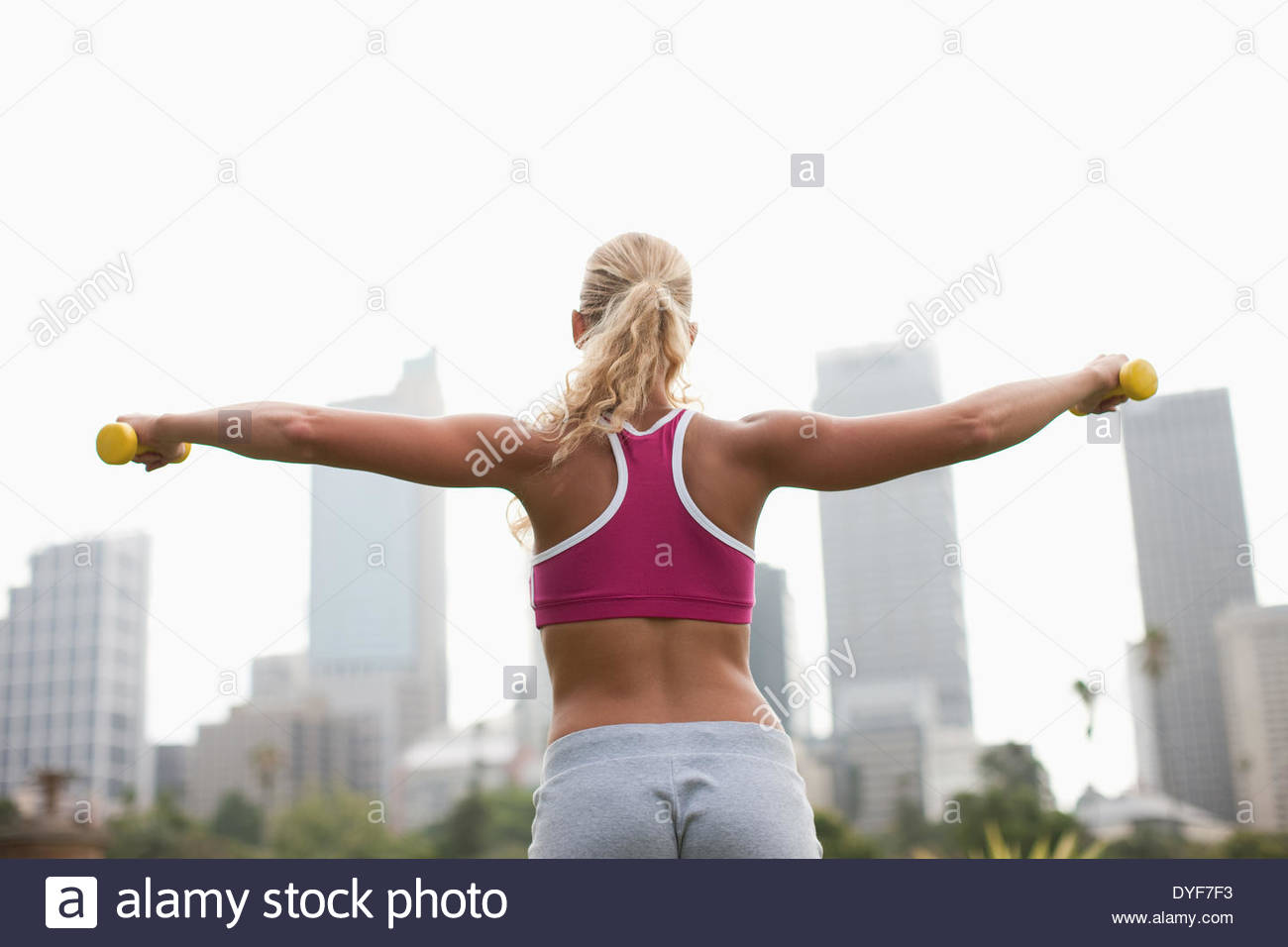 Woman lifting weights Photo Stock