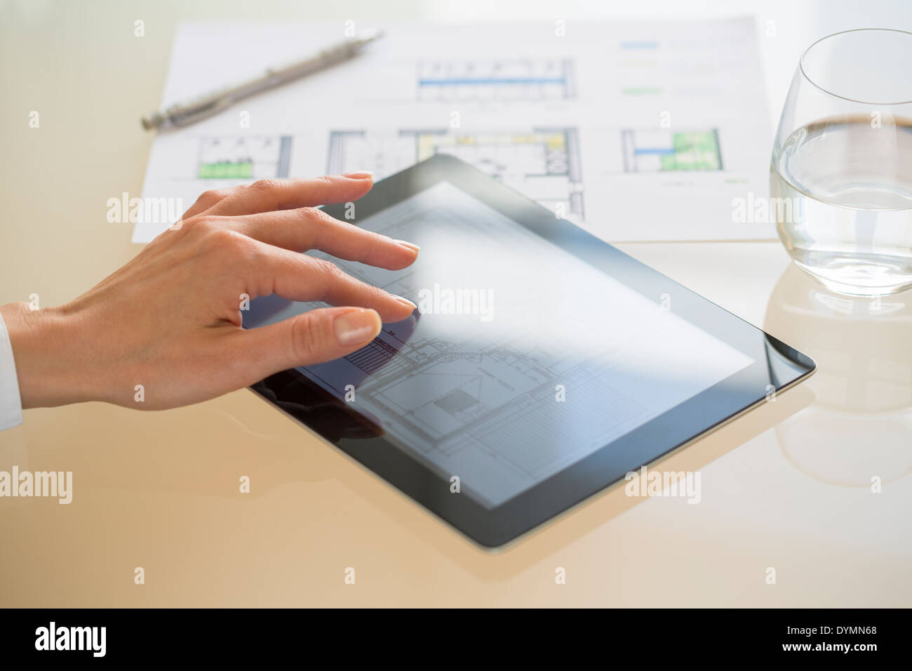 Close-up of Hands Architect Woman Using Tablet pc in office Photo Stock