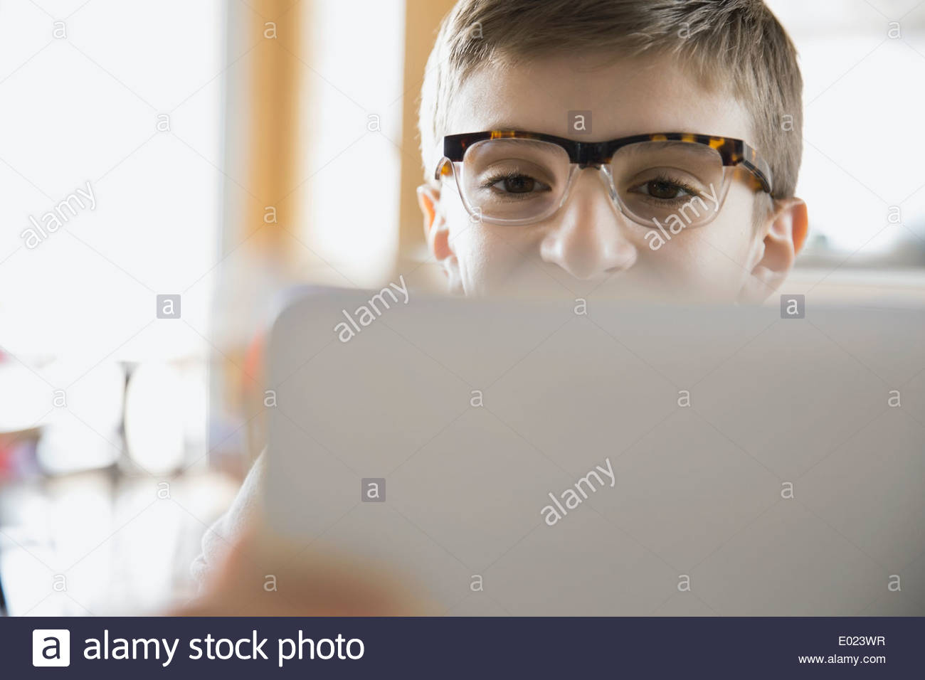 Close up of school boy using laptop in classroom Photo Stock