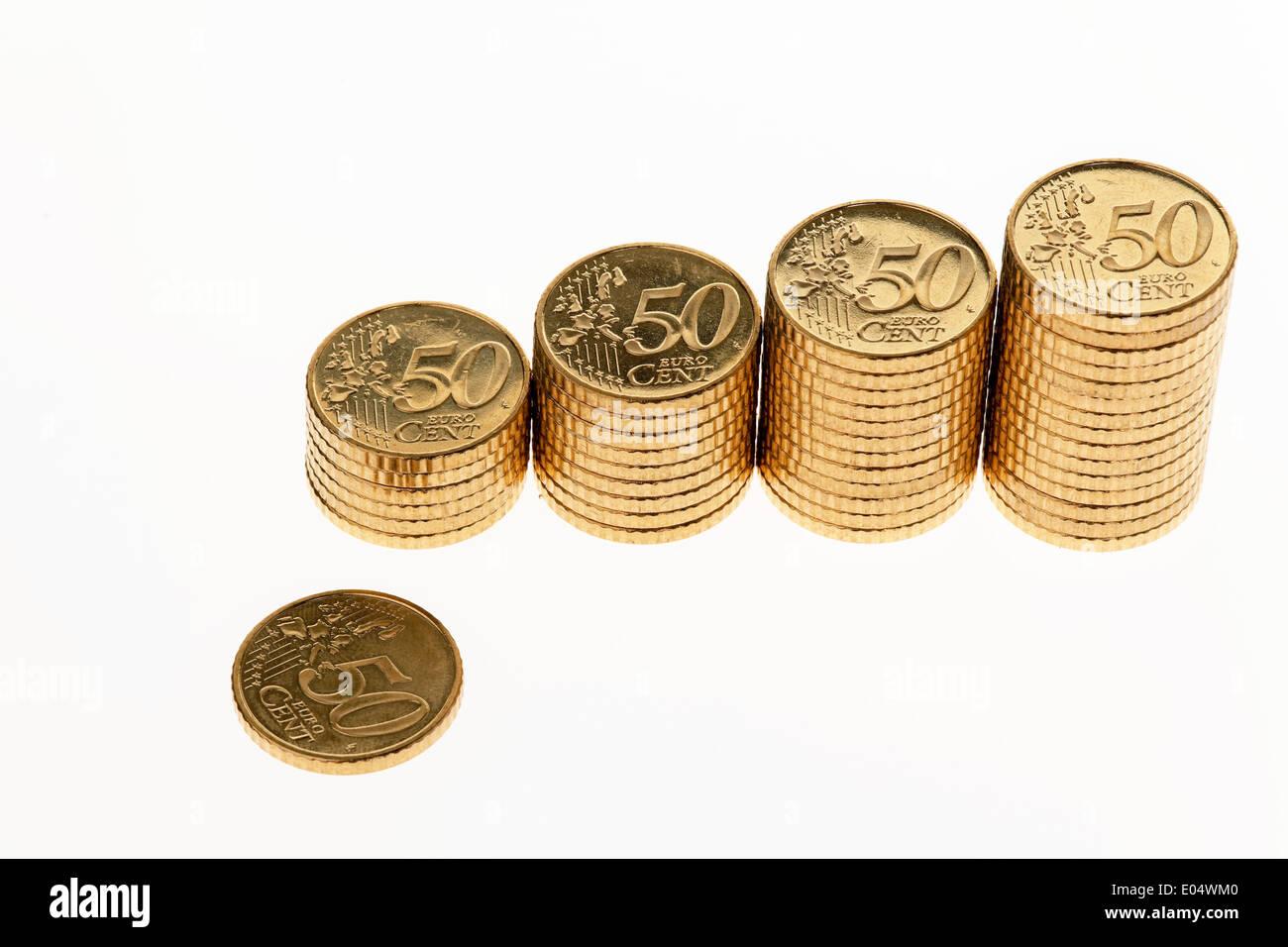 Einige Stapel Von Euro Geld Muenzen Auf Weissem Hintergrund Photos