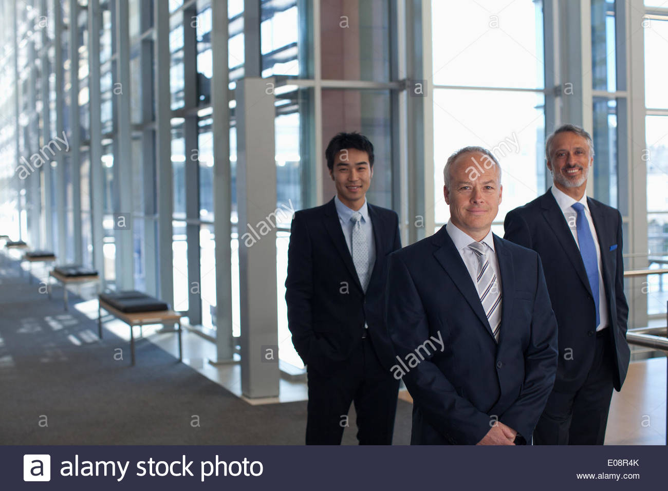Business people in office lobby Photo Stock