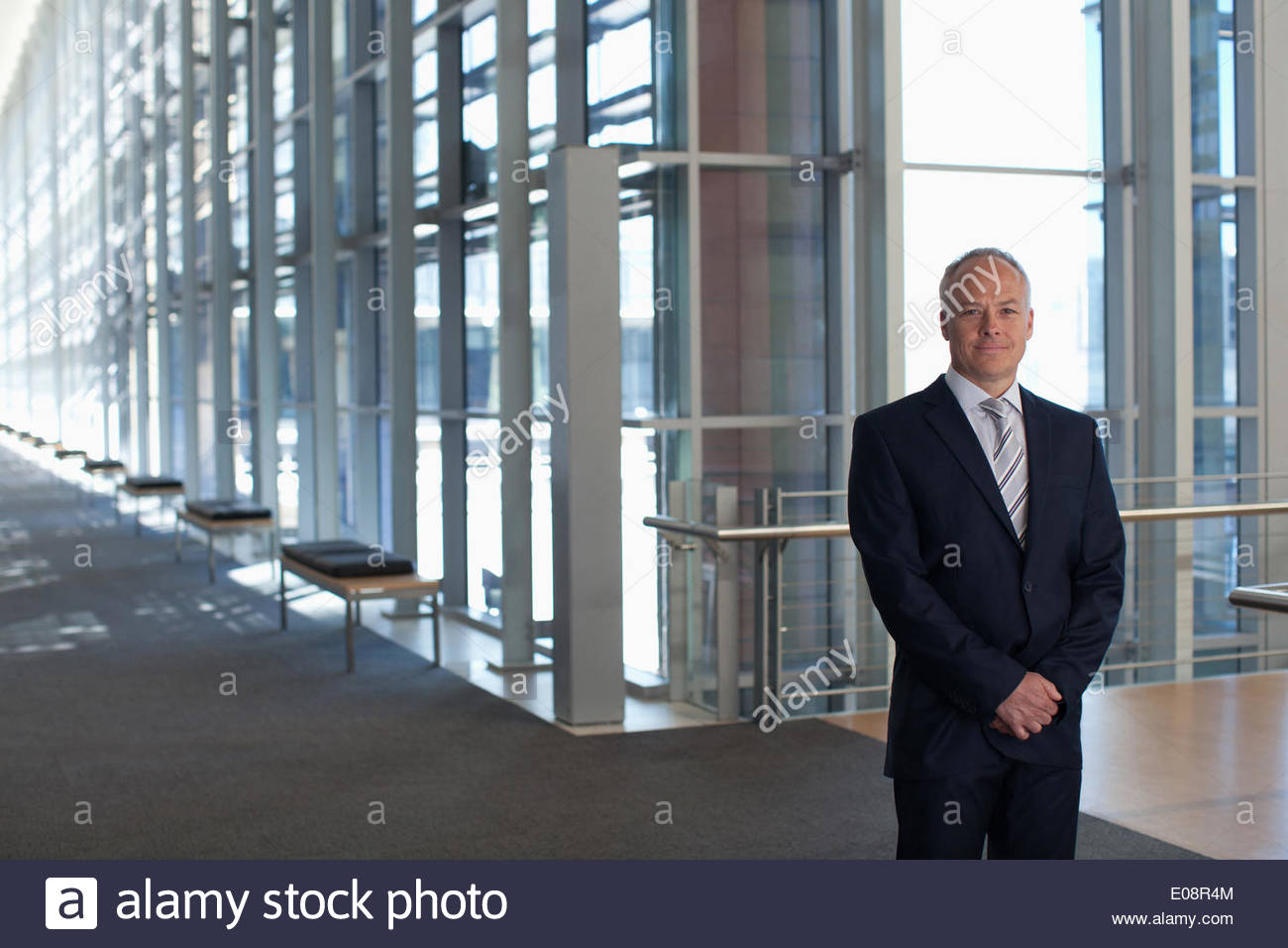 Businessman in office lobby Photo Stock