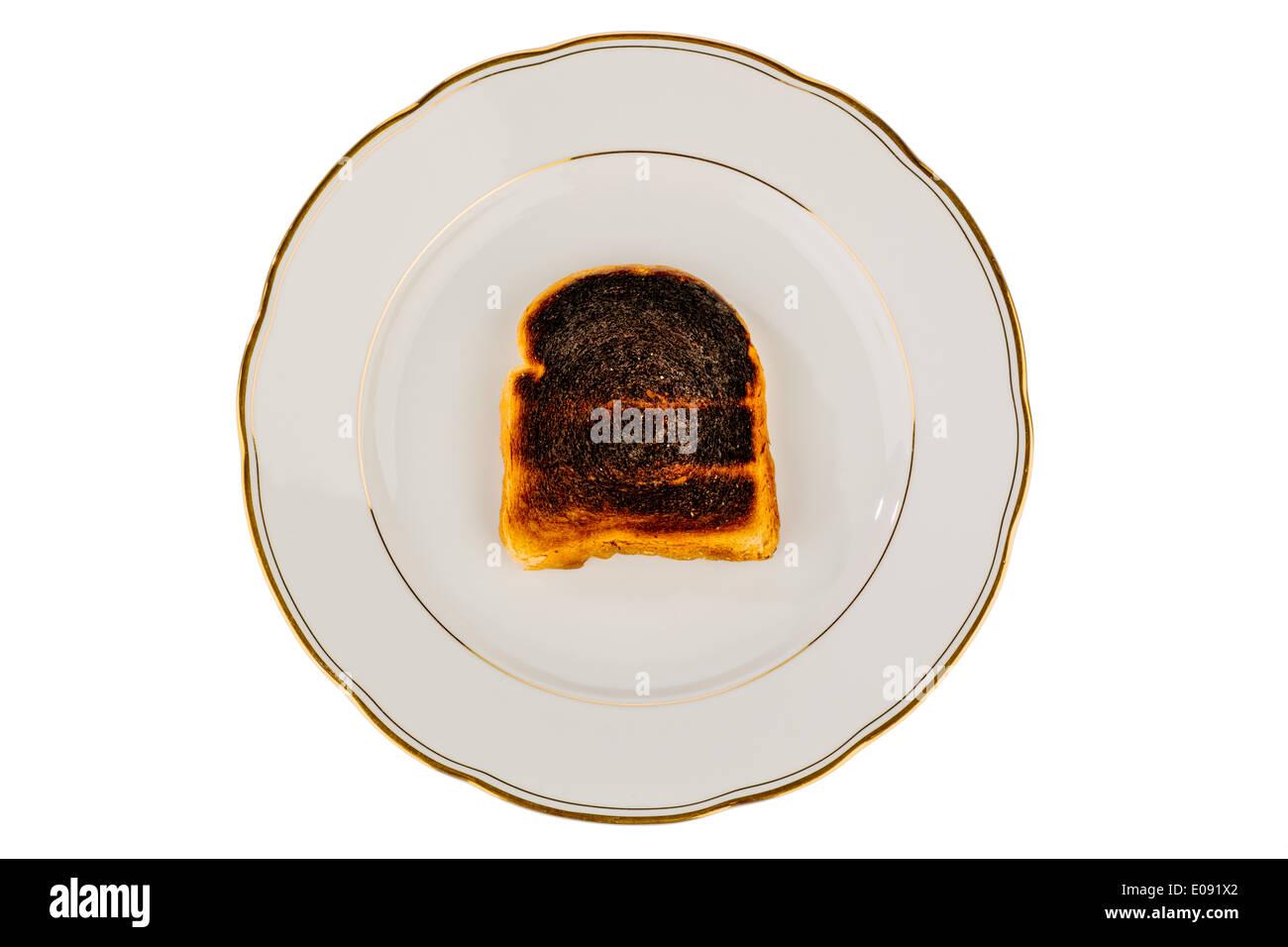 Griller le pain est devenu un toast avec burntly. Burntly avec disques toast le petit-déjeuner., toasten Toastbrot wurde beim verbrannt. Banque D'Images
