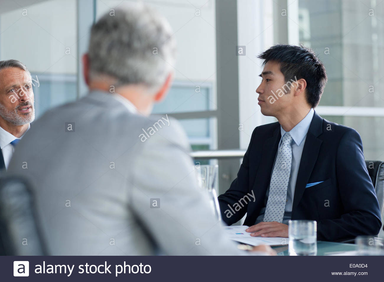 Businessman with co-workers Photo Stock