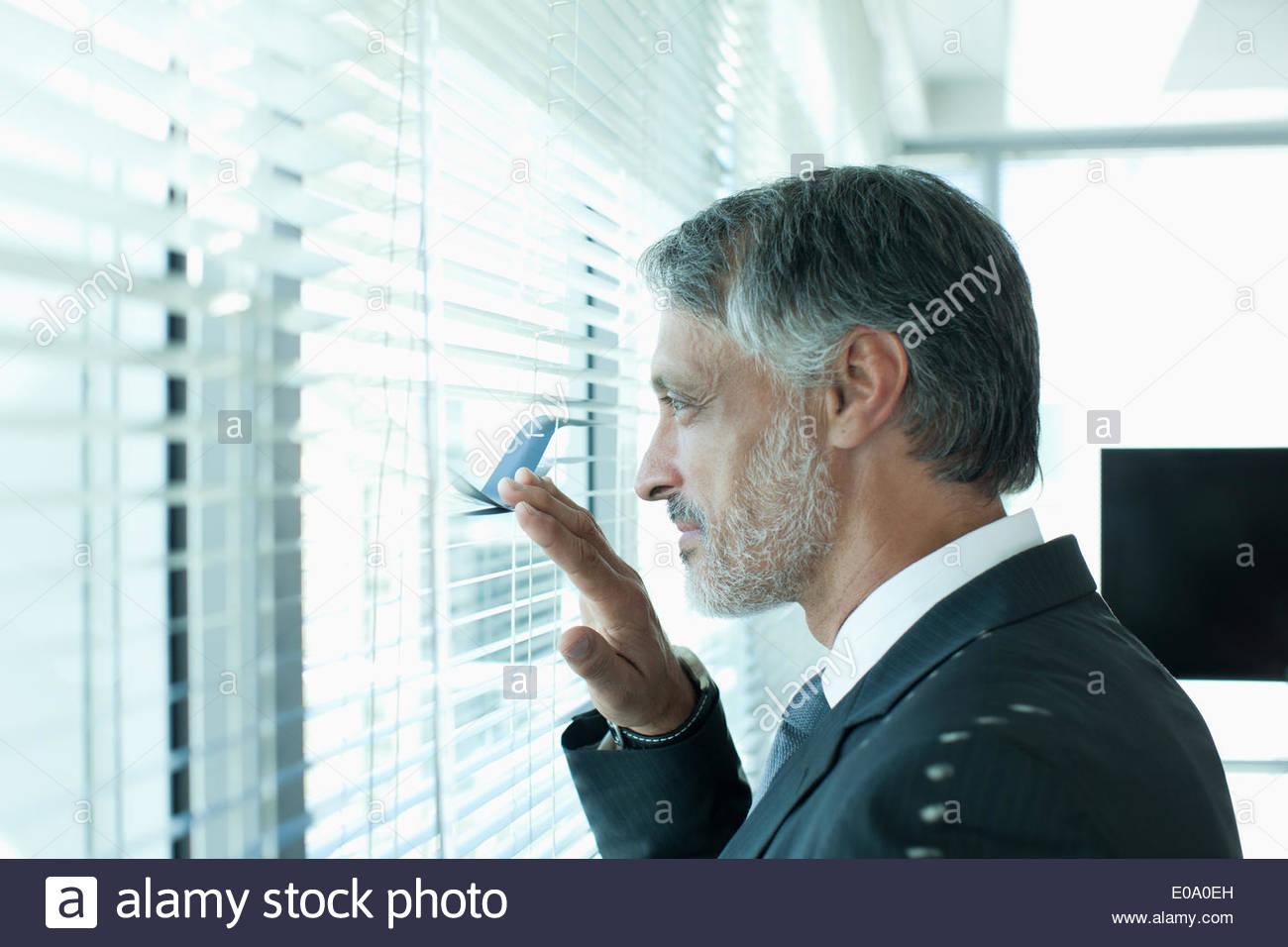 Portrait of businessman at window Photo Stock