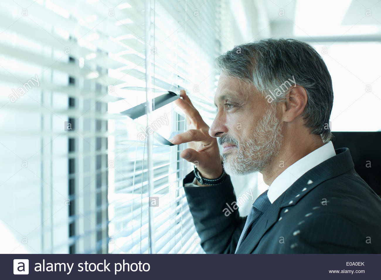 Portrait of businessman at window Photo Stock
