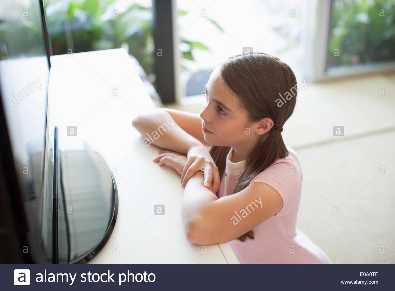 Girl watching TV Photo Stock