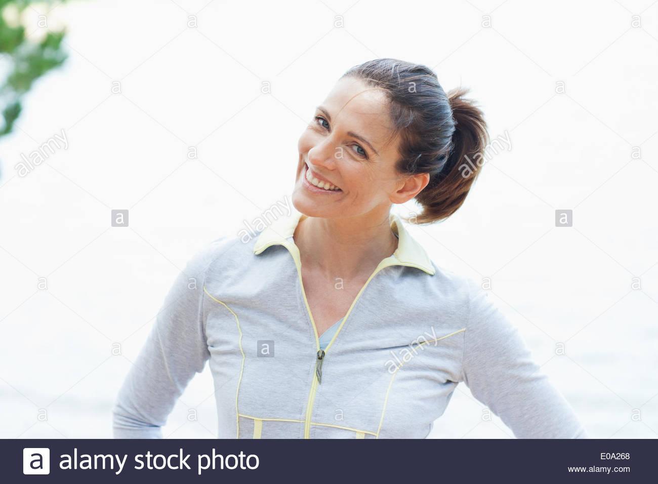 Woman in sportswear smiling Photo Stock