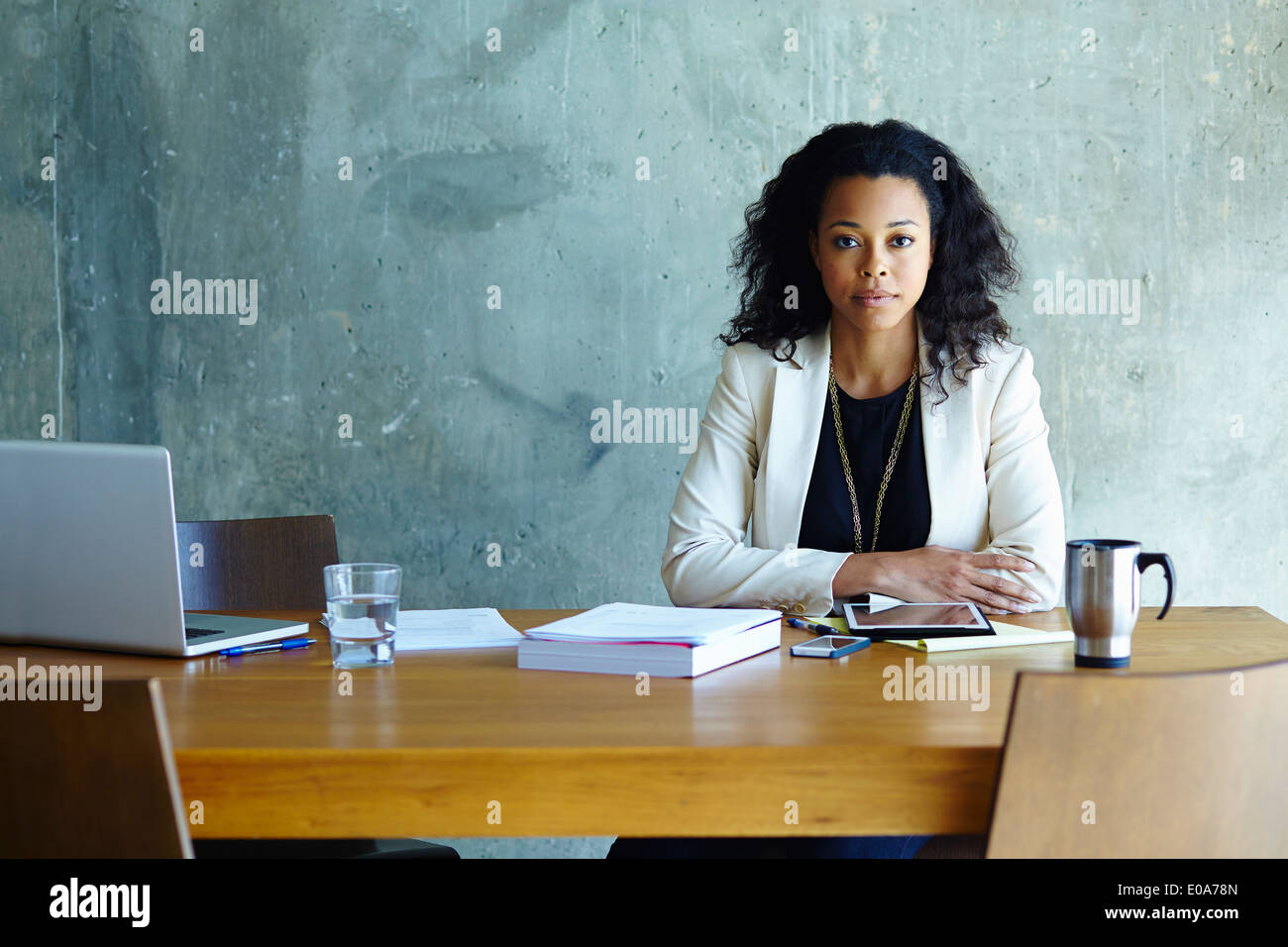 Portrait of young businesswoman at conference table Photo Stock