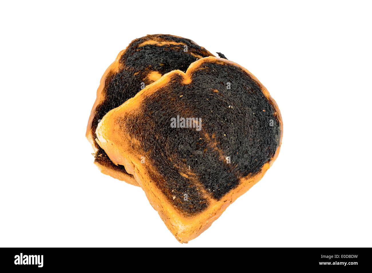Griller le pain s'burntly. Burntly avec disques toast le petit-déjeuner., toasten Toastbrot wurde beim verbrannt. Banque D'Images