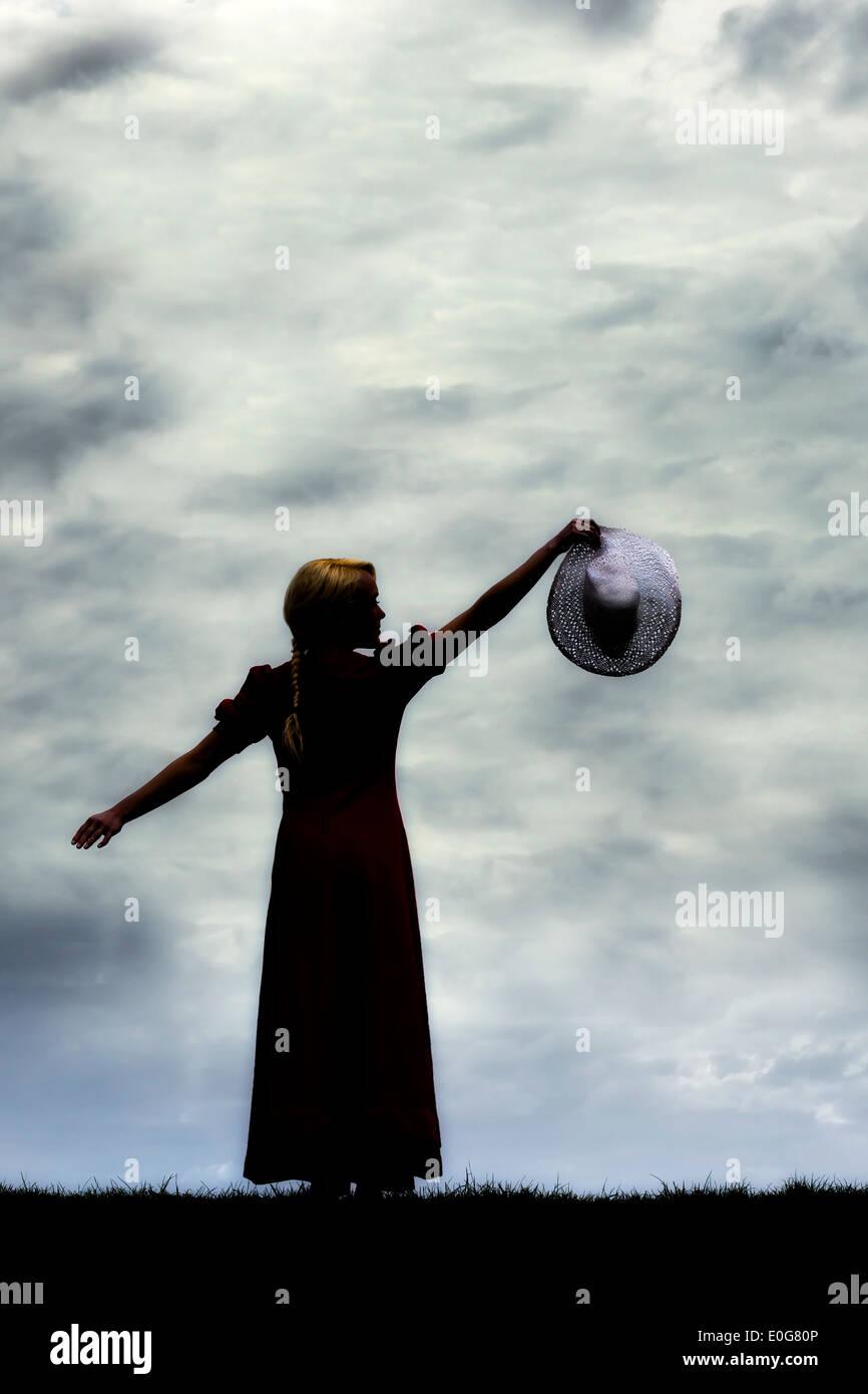 Silhouette d'une femme avec un chapeau Photo Stock