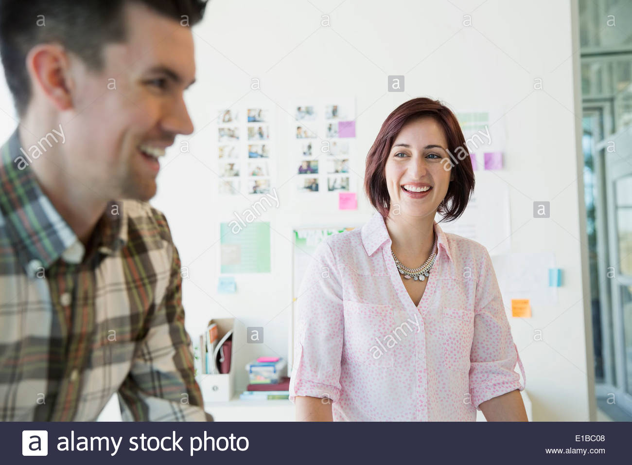 Smiling business people in office Photo Stock