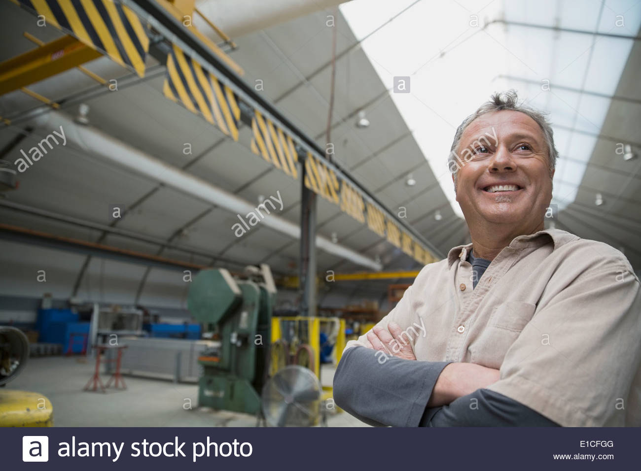 Working in manufacturing plant Photo Stock