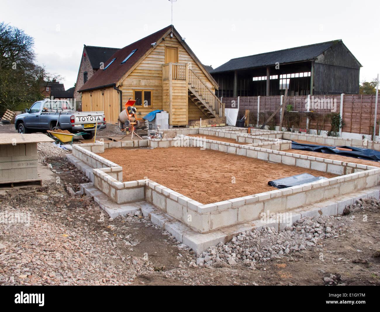 l bâtiment maison, chape de sable compacté sur base de plancher, en