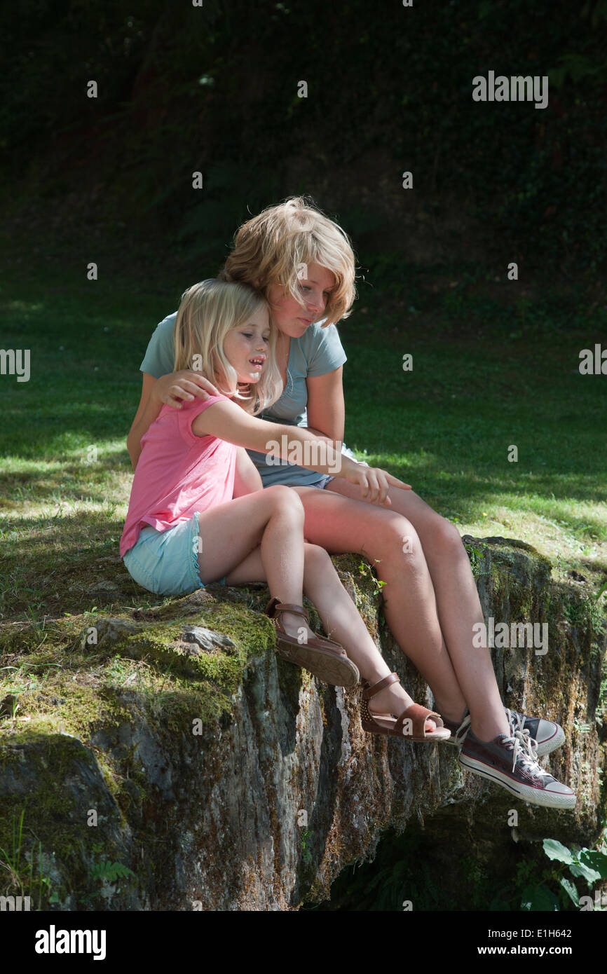 Sisters sitting in garden Photo Stock