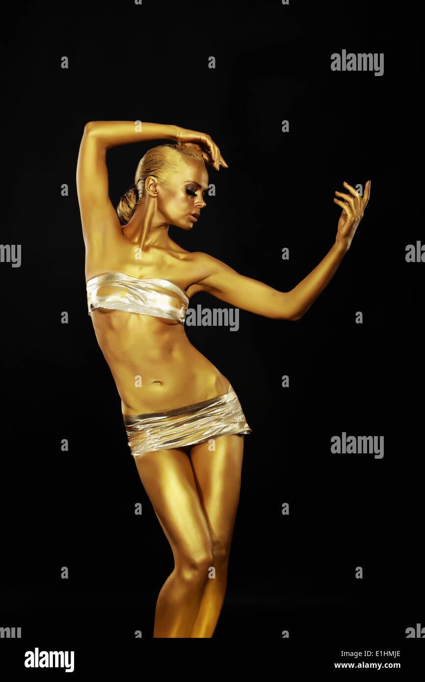 Radiance. Statue en or. Le corps de la femme doré. Bodyart or Photo Stock