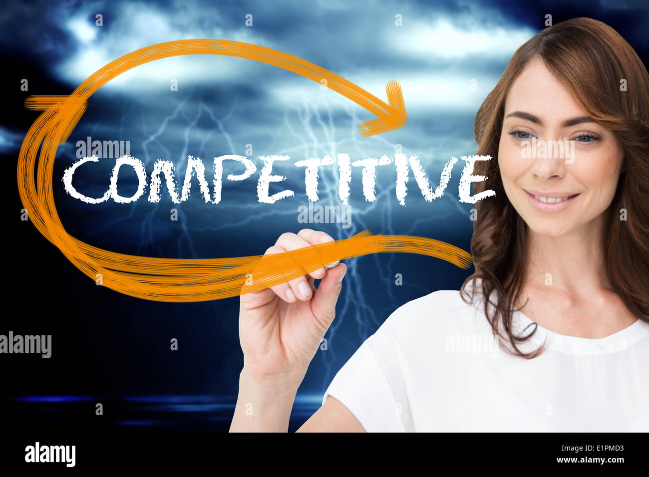 Businesswoman writing the word competitive Photo Stock