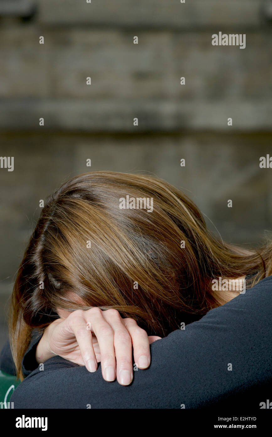 Woman resting head on arms Photo Stock