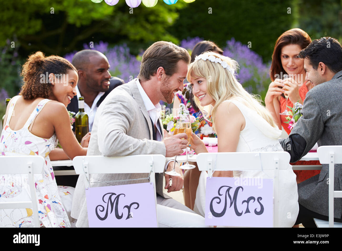 Couple Enjoying Meal At Wedding Reception Photo Stock