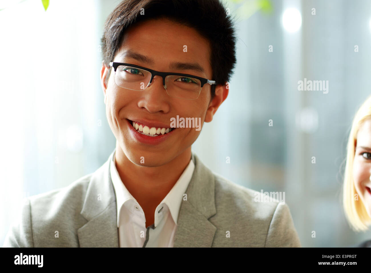 Portrait of a smiling woman in glasses at office Photo Stock