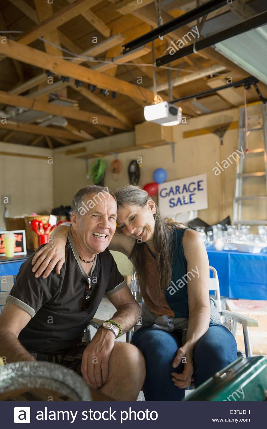 Couple hugging at garage sale Photo Stock