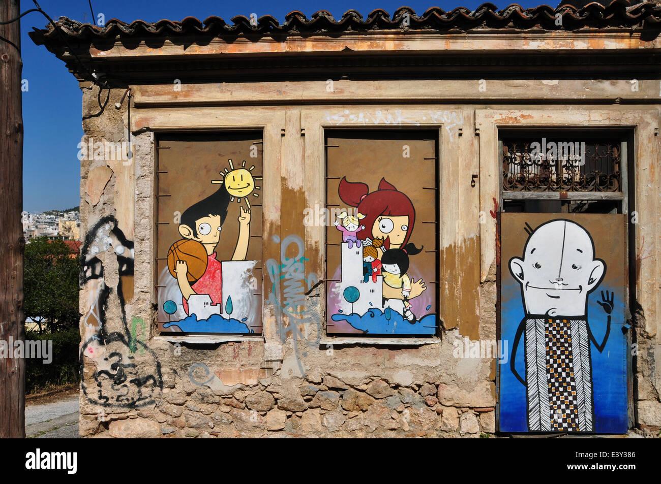 Graffitis colorés joyeux personnages de dessins animés sur la barricadèrent les fenêtres et porte dune maison abandonnée à plaka