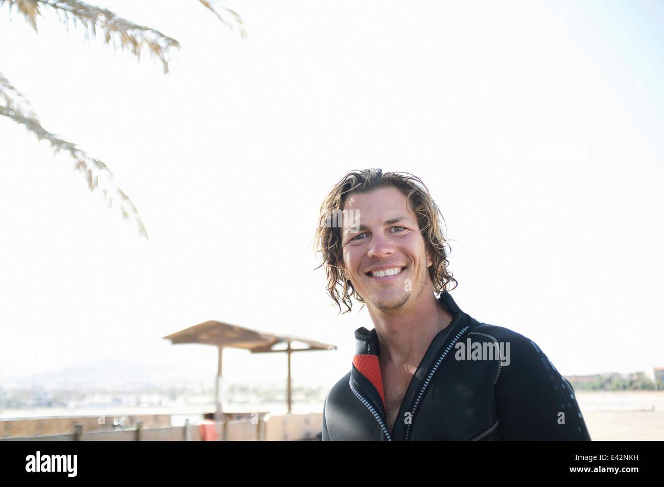 Portrait of mid adult male scuba diver on beach Photo Stock