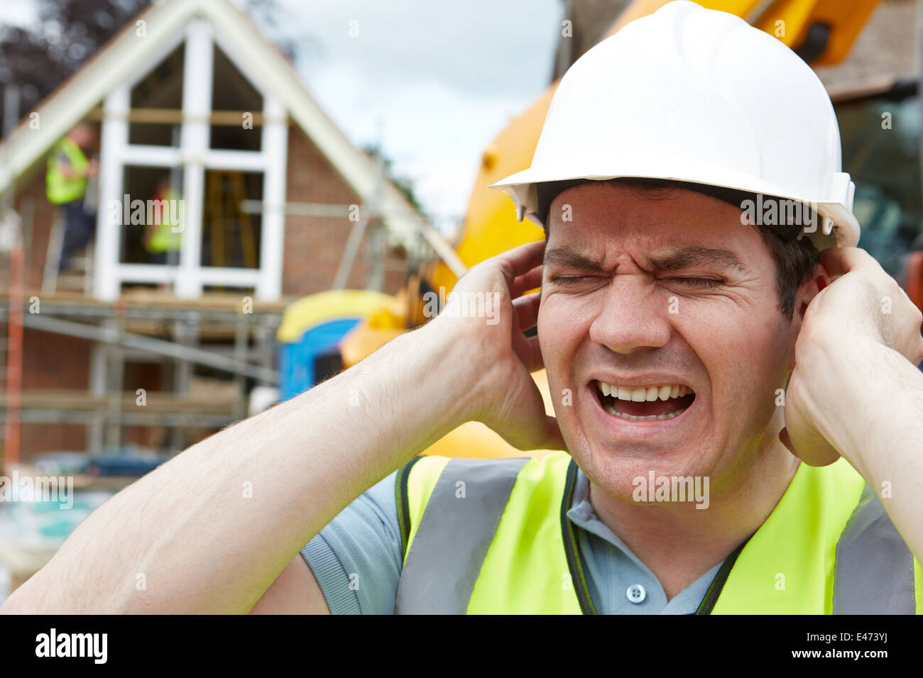 La construction souffre de la pollution sonore sur chantier Photo Stock